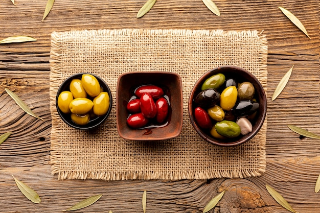 Olives in bowls on textile material