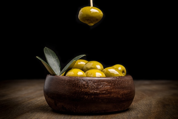Olives with black background