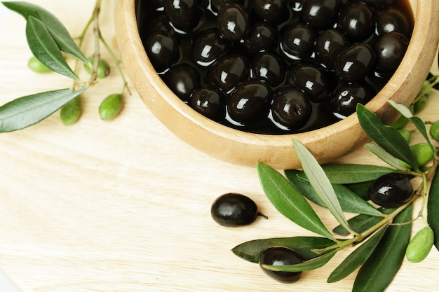 Olives with green leaf on background with copyspace