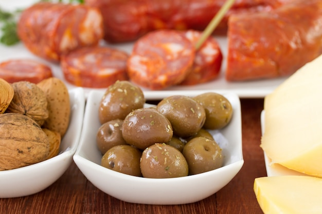 Olives with sausages and cheese