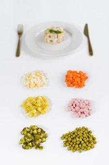 Olivier salad and ingredients for cooking