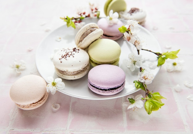 Ð¡olorful french macaroons on tile surface