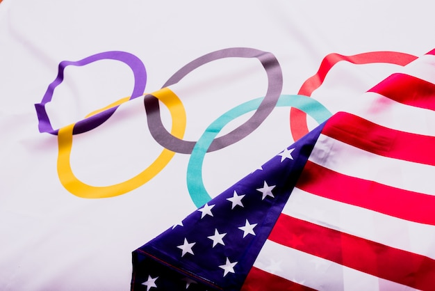 Olympic flag folded under the american flag after collecting the materials for the olympic games after knowing of its suspension.