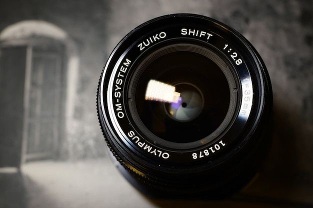 Olympus om shift lens 35mm f2.8 on a photography book