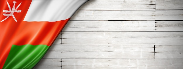 Oman flag on old white wall.