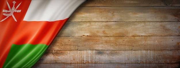 Oman flag on vintage wood wall