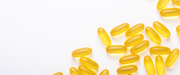 Omega 3 capsules  fish oil yellow softgels vitamin d, e, a supplement concept of healthcare banner