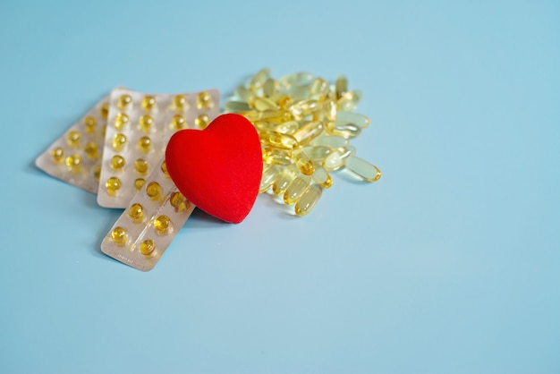 Omega 3 capsules with red heart