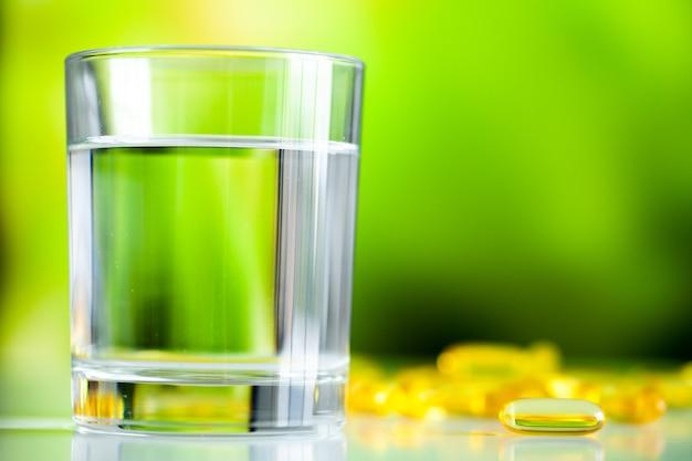 Omega 3 fish oil yellow soft gel capsules.