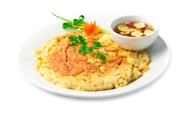 Omelet fried eggs thai food style inside dish