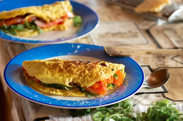 Omelet with tomatoes and arugula