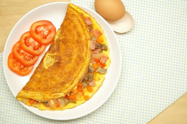 Omelette (omelet, scrambled egg) with ham, tomato, onion,carrot, champignon mushroom