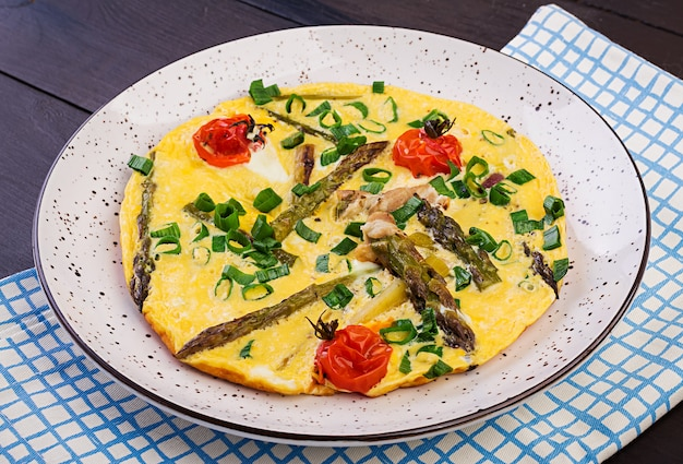 Omelette with asparagus and tomato for breakfast