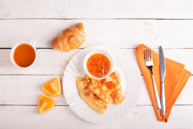 Omelette with pumpkin, carrot juice