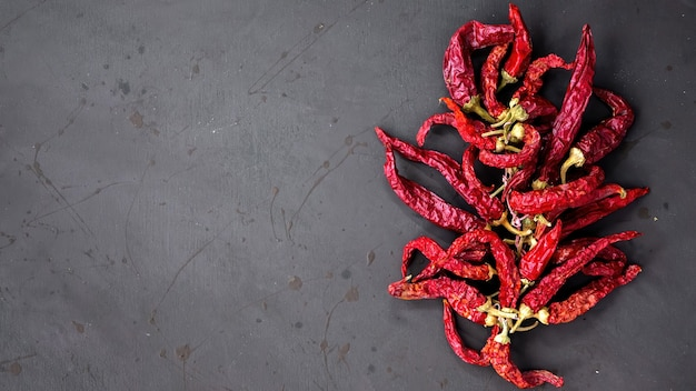 ?omposition of chili peppers, dark background