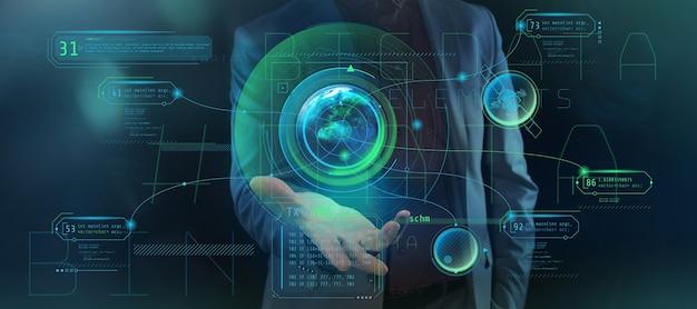 男性の手のひらに、追加のインフォグラフィックデータを含む惑星地球の投影。