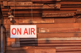 ON AIR sign light box hang on old wood background old.