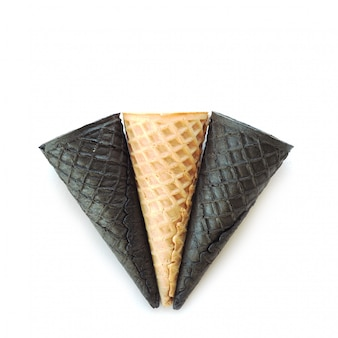 One beige and two black empty ice cream cones. isolate on white background.