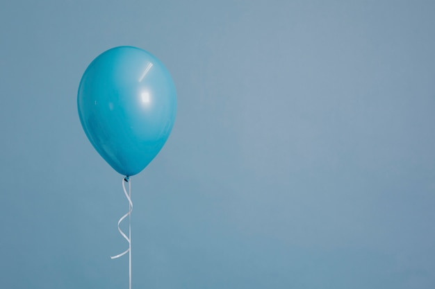 One blue balloon