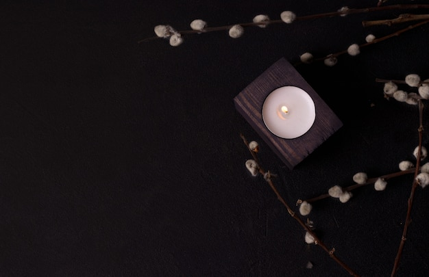 One candle in a wooden candlestick