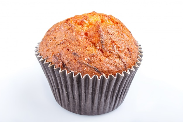 One carrot muffin isolated on white background