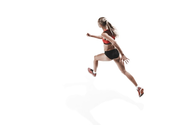 The one caucasian female silhouette of runner running and jumping on white studio background. the sprinter, jogger, exercise, workout, fitness, training, jogging concept. back view