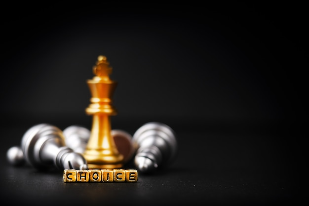 One chess golden piece, remaining against the chess pieces. strategy, planning and the concept of decision-making, choice. word-choice. copy space for your text