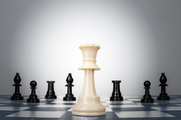 One chess pieces staying against thel set of chess pieces. strategy, business