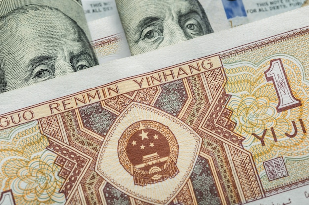 One chinese yuan banknote onto various us dollar