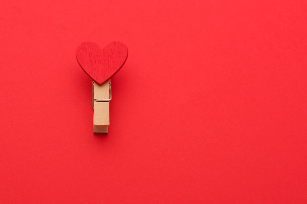 One clothespin with love on a red background