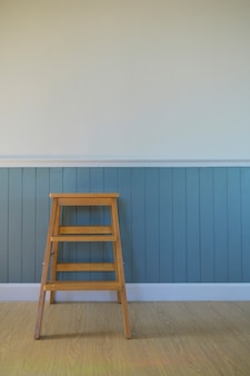 One corner of a vintage style house with a white folk wood wall.