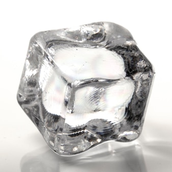 One cube of ice on a white background close up