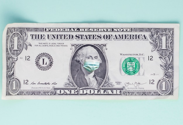 One dollar bill with medical mask