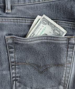 Банкнота один доллар в кармане.