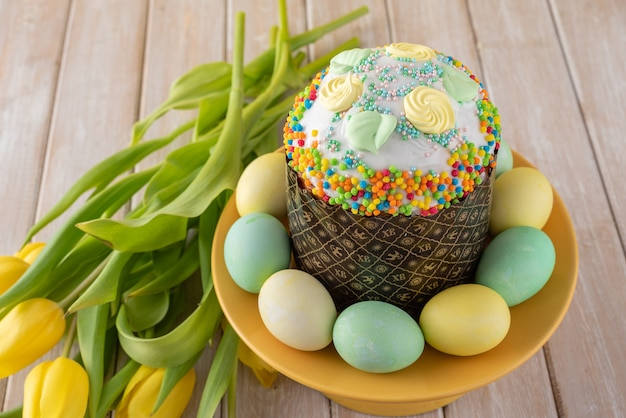 One easter cake in brown paper form on yellow bright.