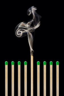 One extinguished match in a group of green matches emotional burnout stress worklife balance