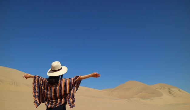 One female enjoy the awesome view of huacachina desert in ica region of peru
