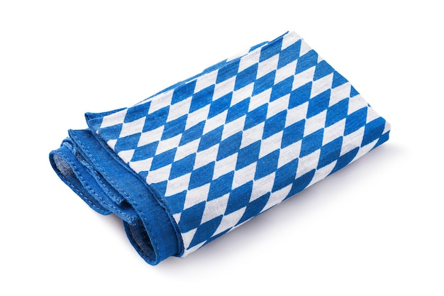 One folded napkin with blue and white color isolated on background