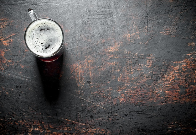 One glass of beer. on dark rustic background
