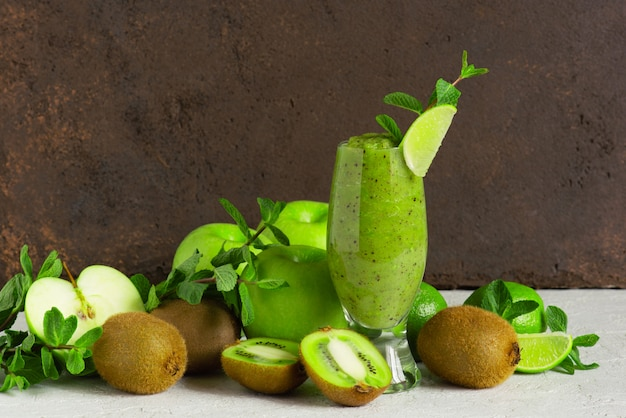 One glass of fresh green fruit smoothie on the table