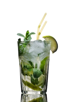 One glass of mojito cocktail on white insulated background studio