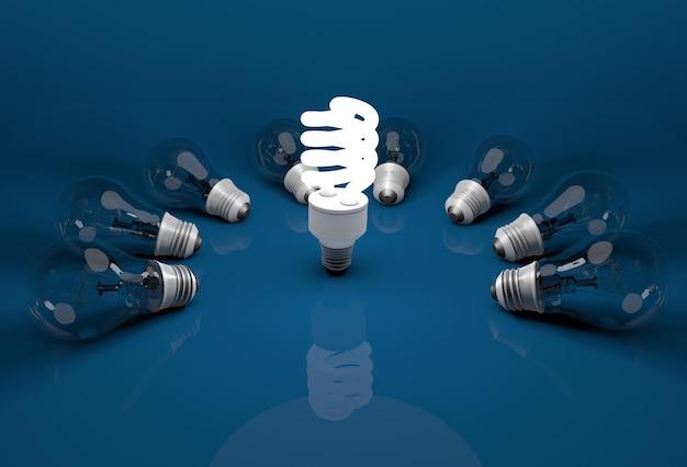 床に横たわっている死んだ白熱電球の中の 1 つの輝く省エネ電球