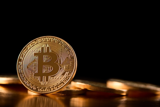 One golden bitcoin on its edge shown on the background of other cryptocurrencies introducing future trend of virtual money.
