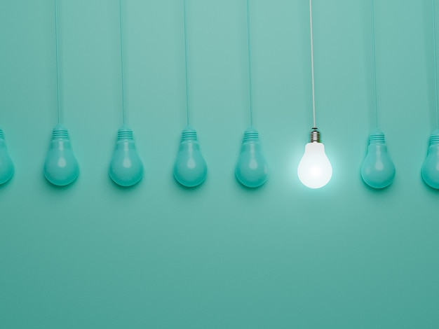 One hanging light bulb glowing from others bulbs on blue background for outstanding ,different creative thinking idea and innovation concept by 3d render.