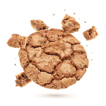 One homemade oatmeal cookie with small pieces isolated on white background