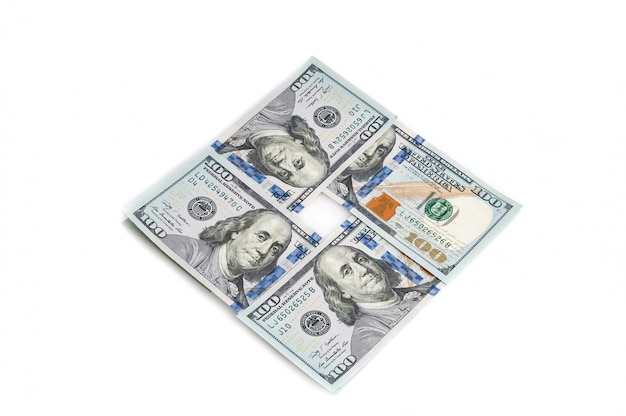 One hundred american dollars stacked in a square on a white background