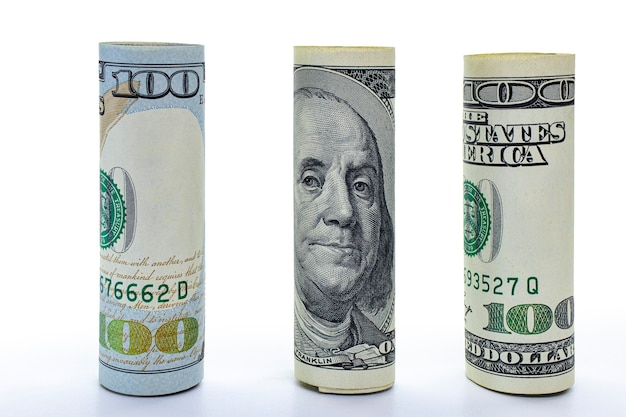 One hundred dollar banknote rolled into a tube. close-up. isolated white background. concept for design.