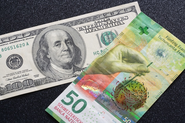 One hundred-dollar bill and 50 swiss francs.