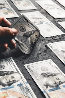 One hundred dollar bills are creatively laid out. beautiful original cash flow. one hundred bucks as a background on a long banner in high resolution. business concept, development perspective.