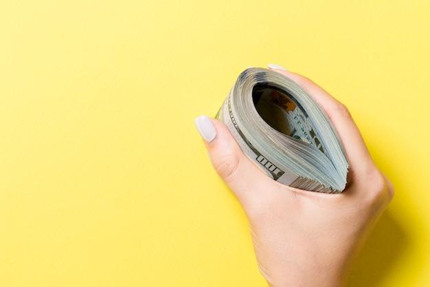 One hundred dollar bills in female hand